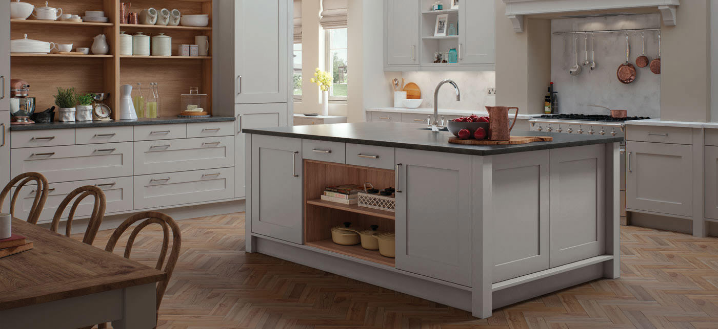 Modern shaker style kitchen, Long Eaton, Nottingham. Timber kitchen floor, smooth painted kitchen cabinet doors. kitchen Storage features. Dark stone worktops.